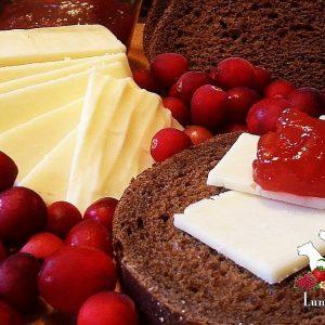LunaGrown Cranberry Jam with NY Sharp Cheddar on Pumpernickel Bread.